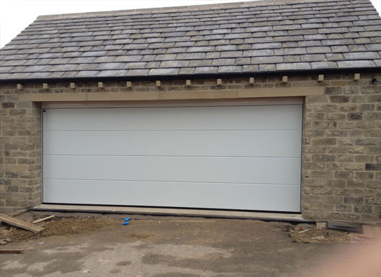 Large sectional garage door installation