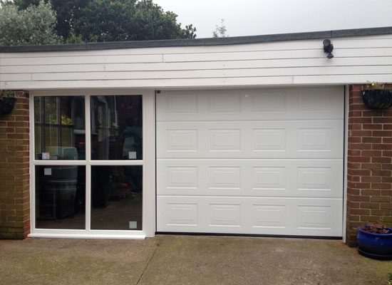 Garage door with side window